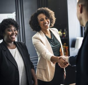 Young women greeting male client