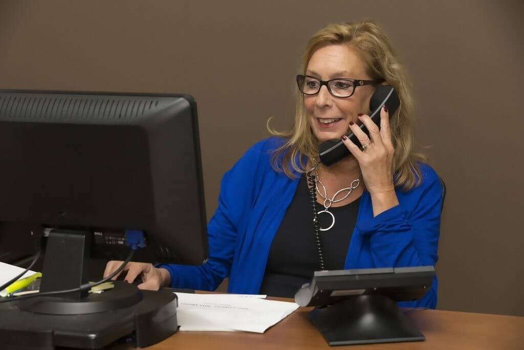 Woman working in office speaking on phone