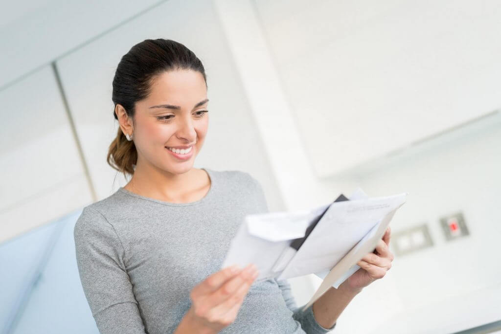 Woman reading direct mail piece