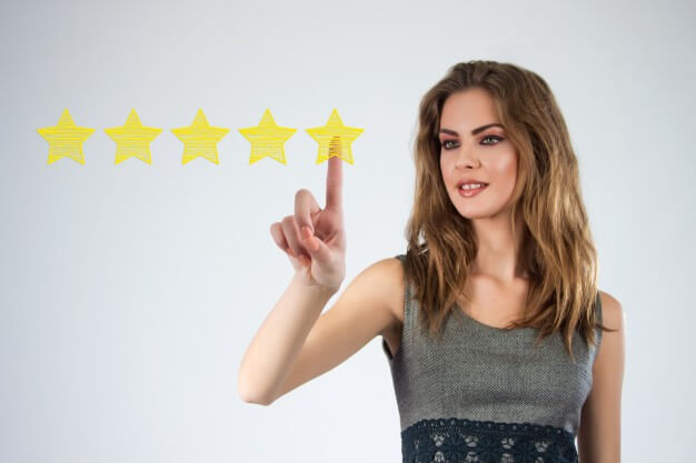 woman giving 5 star marketing review