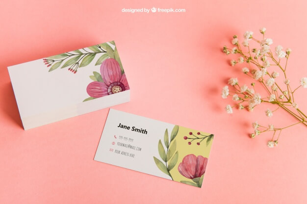 floral printed business cards on pink background