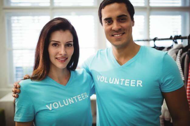 man and woman volunteers posing