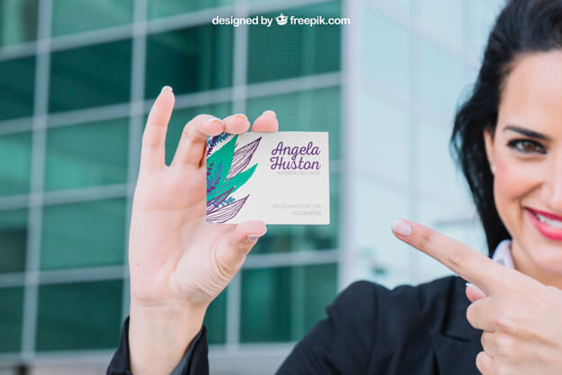 woman pointing at business card
