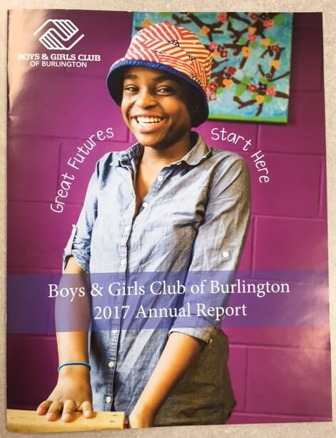 boys and girls club annual report cover with young girl smiling in front of purple background