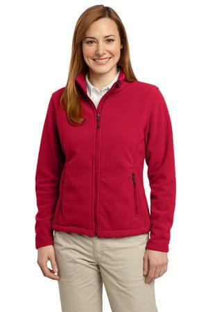 young woman wearing red fleece jacket and khaki pants