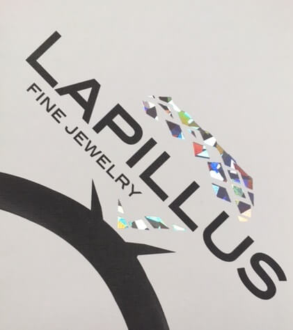 Brochure imprinted with ink and silver foil
