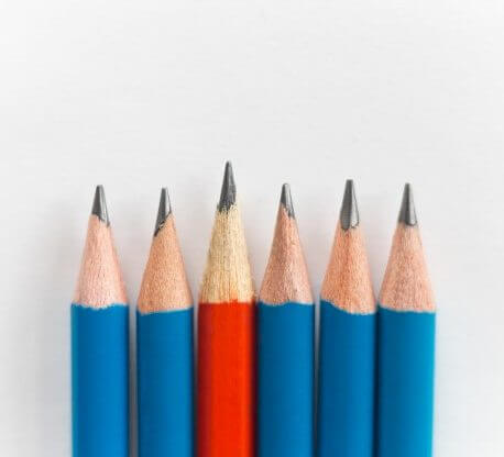 group of pencils one red among the blue