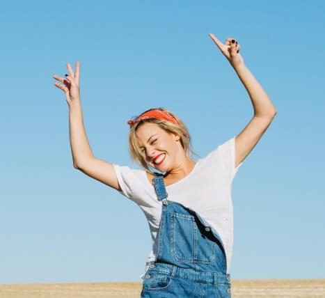 Smiling woman posing in field