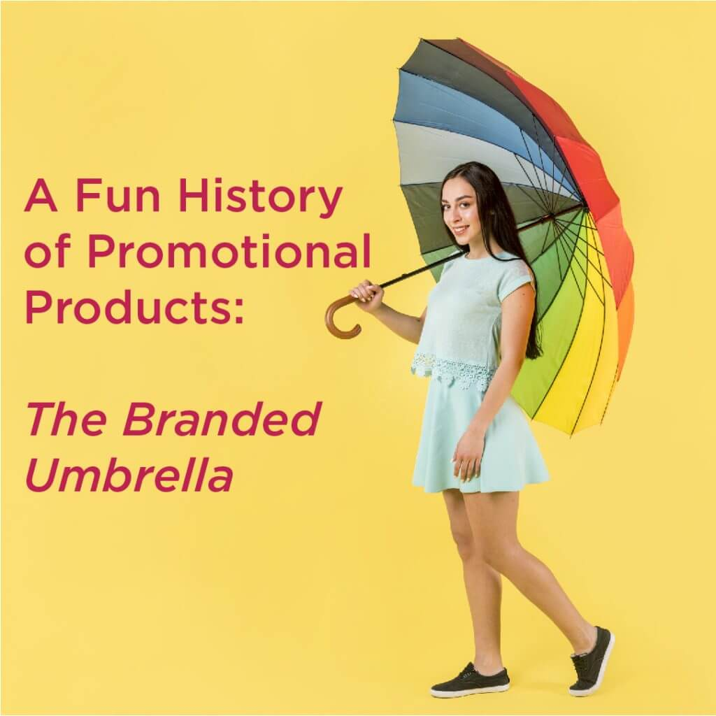 Woman holding rainbow colored umbrella
