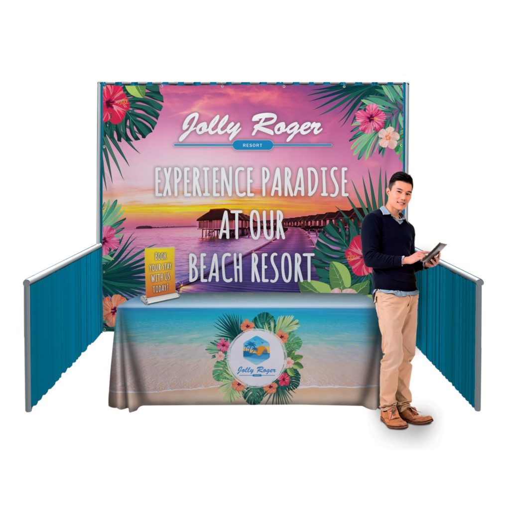 Man standing next to branded trade show booth